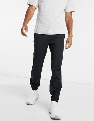 Lacoste motion relaxed fit water resistant chino trousers