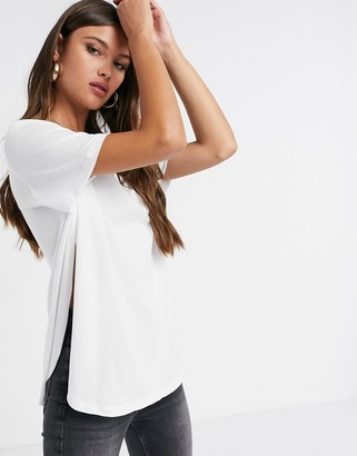 ASOS DESIGN t-shirt with curved hem and side splits in white
