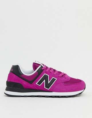New Balance 574 sneakers in fuchsia and black