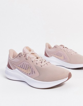 Nike Running Downshifter sneakers in pink