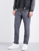 Brunello Cucinelli Leisure-fit tapered wool trousers