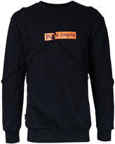 Palm Angels lace-up patched sweatshirt