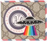 Gucci badges GG Supreme wallet - men - Leather - One Size