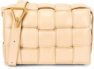 Bottega Veneta Padded Cassette Crossbody Bag in Porridge & Gold | FWRD
