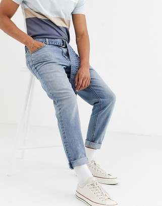 ASOS DESIGN stretch tapered jeans in vintage mid wash blue with self belt