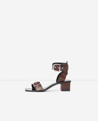 The Kooples Brown heeled leather sandals with snake print