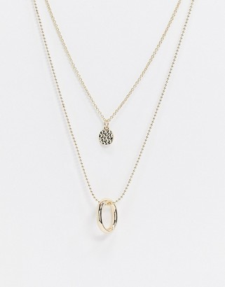 Asos Design DESIGN multirow necklace with open circle and hammered disc in gold tone