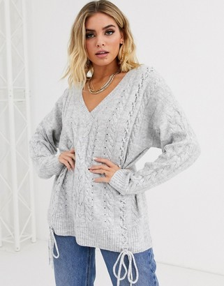 ASOS DESIGN v neck cable sweater with tie detail in recycled blend