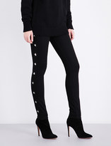 Givenchy Star-studded skinny mid-rise jeans