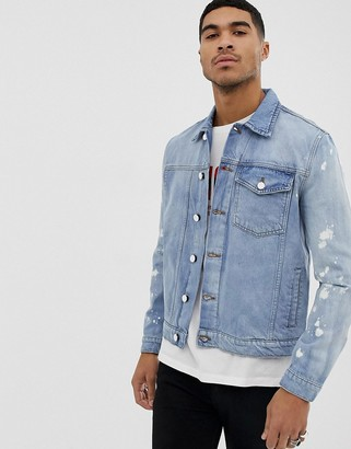 Religion denim jacket with bleach splat sleeves