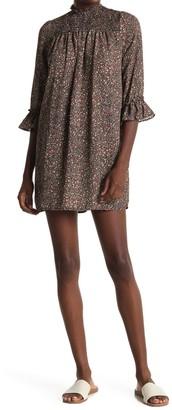 Kenedik Ditsy Smocked Mock Neck Shift Dress