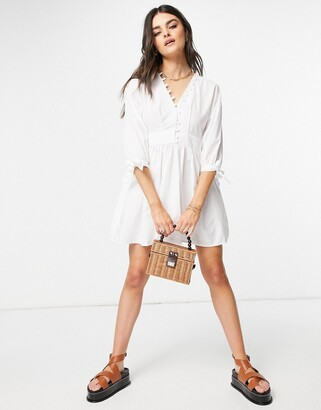 ASOS DESIGN cotton poplin button detail mini smock dress with tie sleeves in white