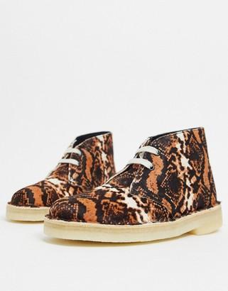 Clarks desert boots in tan snake print