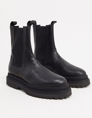 ASOS DESIGN high chelsea boot on stacked sole in black high shine leather