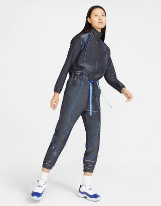Jordan Nike Sisterhood flight jumpsuit in black and hyper royal blue