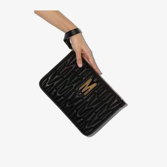 Moschino black quilted leather clutch bag