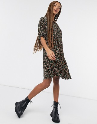 ASOS DESIGN plisse mini smock dress with dip hem in black and orange floral print