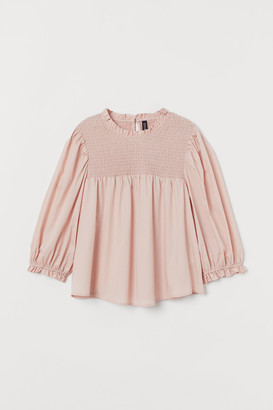 H&M Smocked cotton blouse