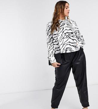 ASOS DESIGN Curve long sleeve top with shoulder pads in zebra print