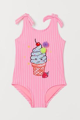 H&M Pompom swimsuit