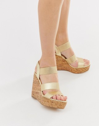 London Rebel high heeled cork wedges-Gold