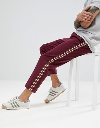Asos DESIGN smart tapered trousers in burgundy with side stripe tape