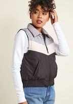 OV173507 Get in touch with your love of throwback fashion by layering this striped vest over your chilly-weather wares! Grey at the collar and shoulders, pink at the center, and black 'round the bottom, this pocketed puffer will feel like it's been an integral par