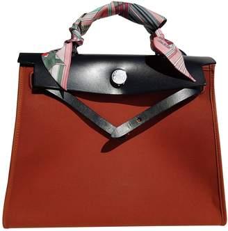 Hermes Herbag Orange Cloth Handbags