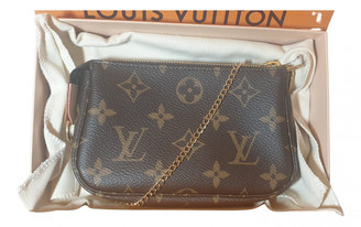 Louis Vuitton Brown Cloth Clutch bags