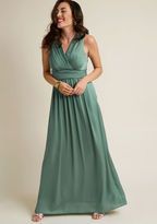 MDD1103 Clad in the sweet sophistication of this sage green gown, you embrace elegance with every twirl of its dimensional pleats and subtle sheen. Polished with a surplice bodice and back, this ModCloth-exclusive beauty makes the most of every marvelous moment s