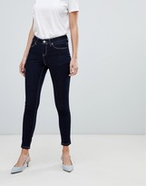 Asos Design LISBON Skinny Mid Rise Jeans in Raw Indigo with Contrast Threads