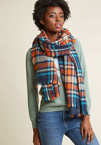 An Oregon adventure calls for this plaid scarf to complete your getaway get-up! Taking cues from the warm colors of the landscape, this toasty, fringed accessory is striped with stone, crimson, teal, navy, and saffron yellow hues, offering both function a