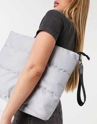 SVNX puffer oversize clutch bag in grey