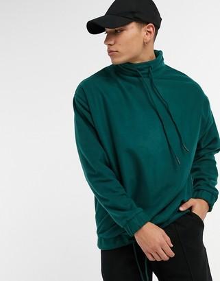 ASOS DESIGN oversized polar fleece sweatshirt with funnel neck in deep forest green
