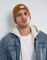 Solid Ribbed Beanie In Mustard