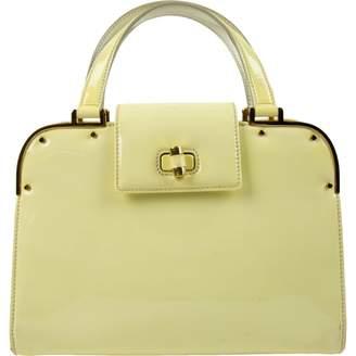 Saint Laurent Yellow Patent leather Handbags