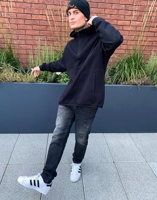 ASOS DESIGN hoodie with half zip and side split in black