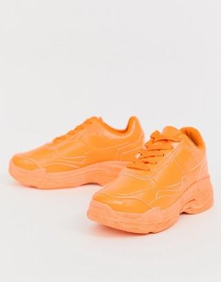 Public Desire Dash neon orange color drenched sneakers