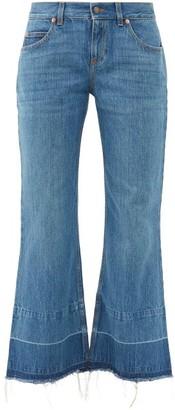 Gucci X Disney Donald Duck Distressed-hem Flared Jeans - Denim