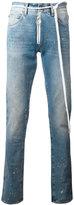 Off-White splitter print slim-fit jeans - men - Cotton/Polyester - 31