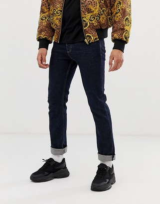Versace skinny jeans in mid wash