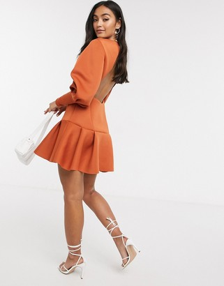 ASOS DESIGN long sleeve seamed pep hem mini dress with open back in rust