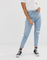 Levi's mom jeans in bleach wash