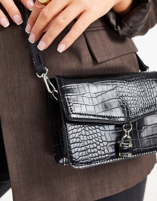 Truffle Collection across body bag in croc with padlock in black