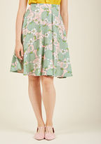 MCB1268 You definitely have that swing when you step out in this pink midi skirt! Part of our ModCloth namesake label, this circle skirt touts a vintage-inspired, high-waisted design in addition to belt loops, pockets, and a throwback print of mint apples and whi