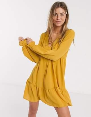Asos Design DESIGN v neck mini smock dress with pep hem in mustard-Yellow
