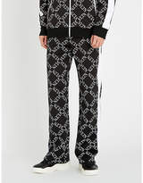 Valentino Logo-print tapered stretch-cotton trousers