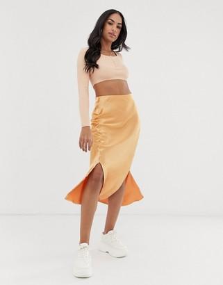 Asos Design DESIGN bias cut satin midi skirt with splits-Orange