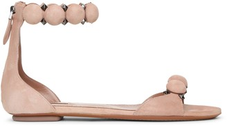 Alaia Bombe beige suede flat sandals
