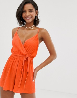 Asos Design DESIGN wrap tie front strappy playsuit in crinkle